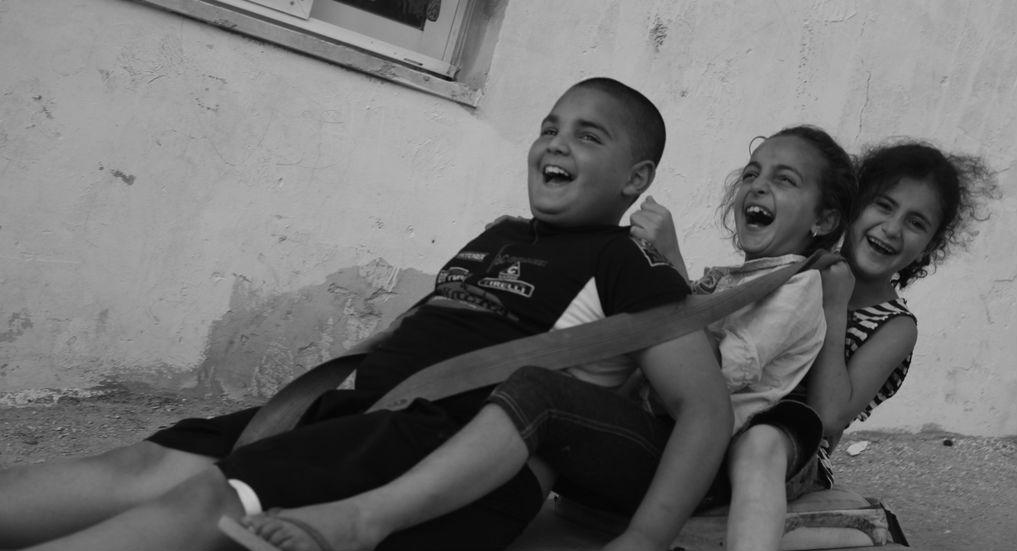 children having fun black and white
