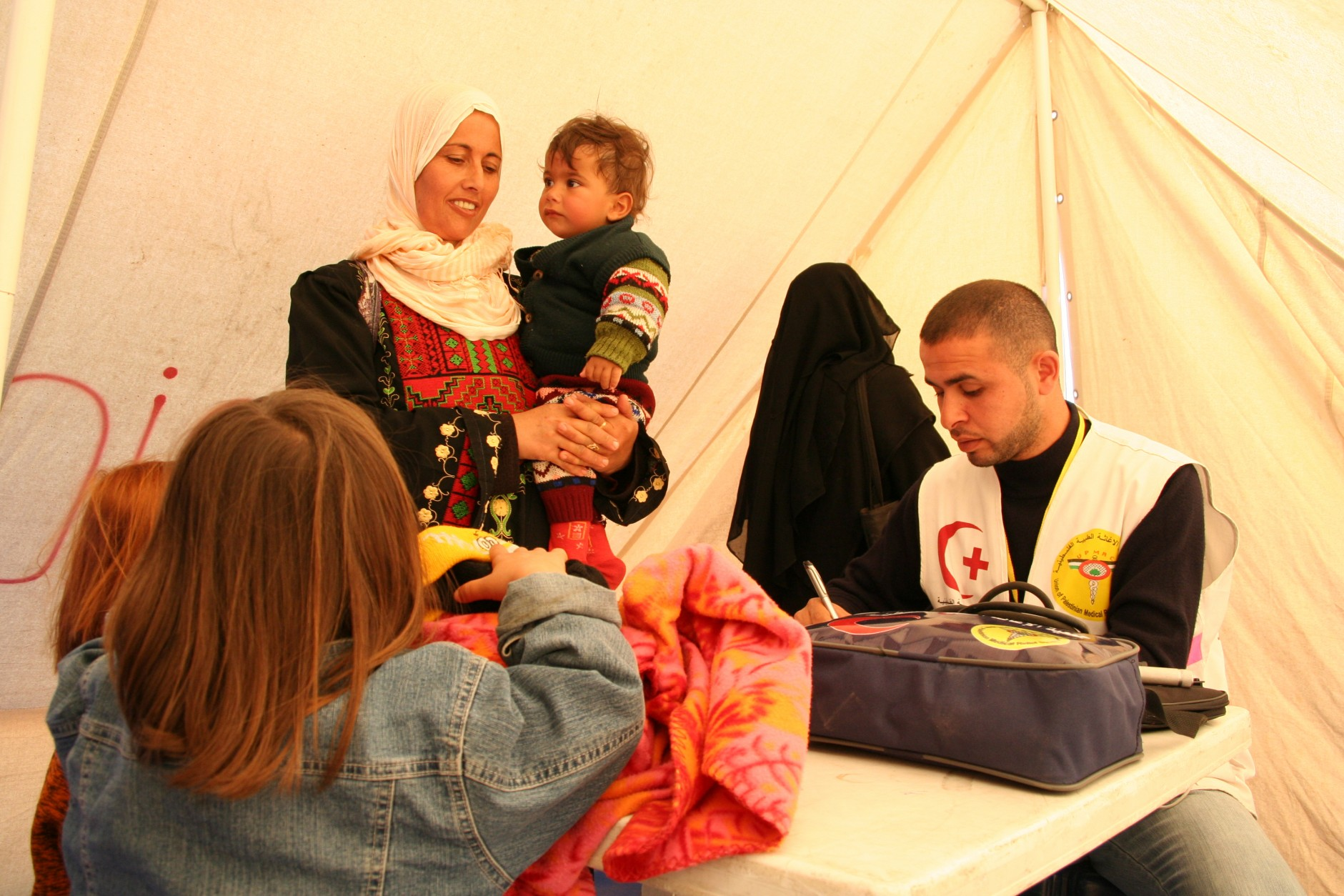 Family in a refugee Red Crescent tent in Gaza