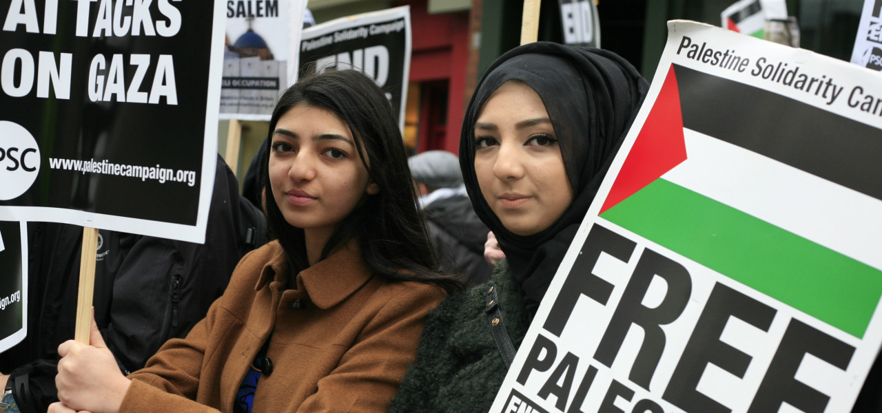 Two women protesting against Israel's war on Palestinians