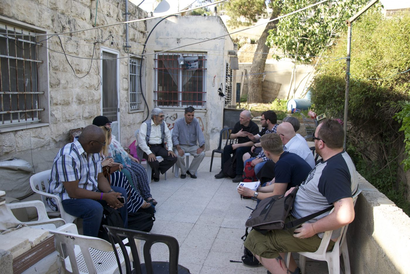 Nabil (on the left) tells the group about his experiences since the Israeli settlers took over half of his home in East Jerusalem